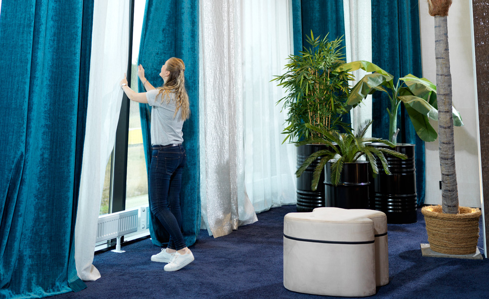 Curtains are an easy way to handle large windows, which may need to be acoustically addressed due to noise or to decrease sunlight.